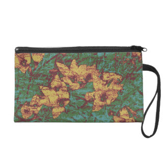 Yellow flower against leaf camouflage pattern 2 wristlet clutches