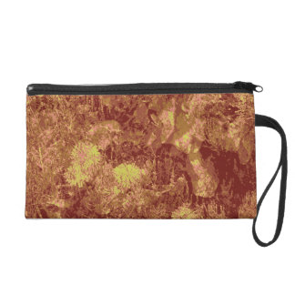 Yellow flower against leaf camouflage pattern wristlet purse