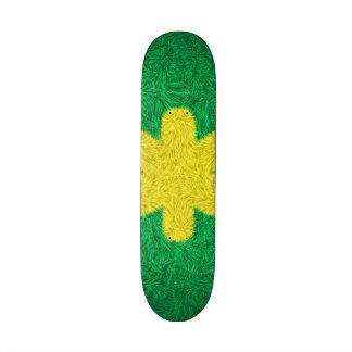Yellow flower on green background skate decks