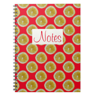 Yellow lemon slices on red notebook