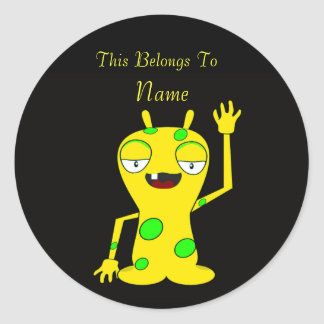 Yellow Monster with Green Spots Waving Hello Round Sticker