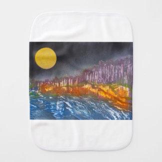 Yellow moon over metamorphic landscape burp cloth