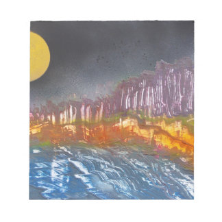 Yellow moon over metamorphic landscape notepad