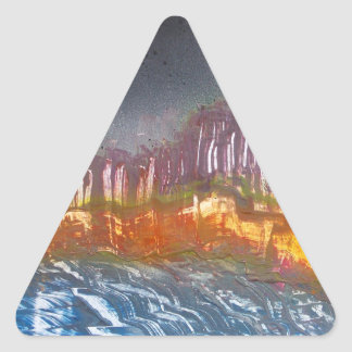 Yellow moon over metamorphic landscape triangle sticker