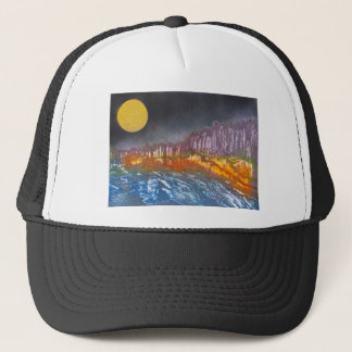 Yellow moon over metamorphic landscape trucker hat