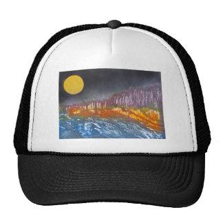 Yellow moon over metamorphic landscape trucker hat