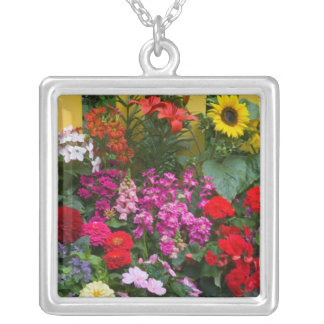 Yellow picket fence with flower garden in silver plated necklace