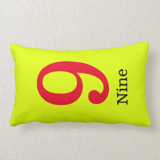 yellow pillow with the number nine