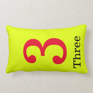 yellow pillow with the number three