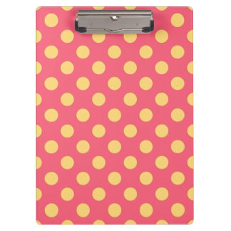 Yellow polka dots on coral clipboards