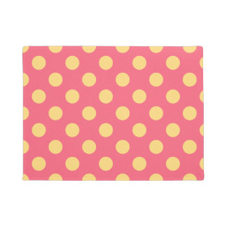 Yellow polka dots on coral doormat