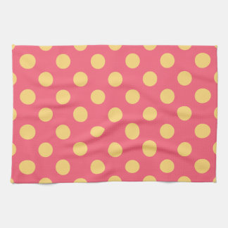 Yellow polka dots on coral kitchen towels