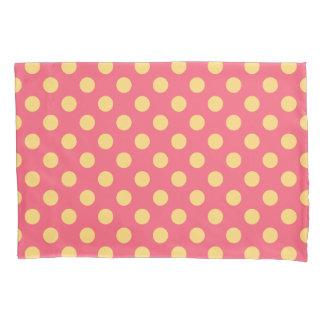 Yellow polka dots on coral pillowcase