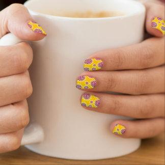 Yellow, purple, silver spinning stars pattern nail minx nail art