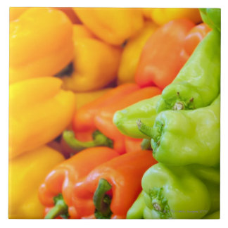 Yellow, red and green pepper on sale at farmer's tile
