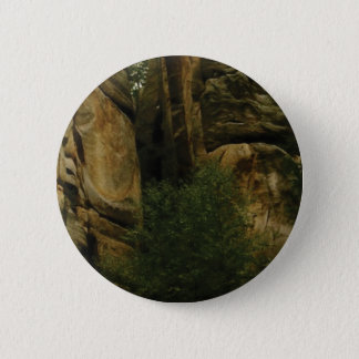 yellow rock face with trees 2 inch round button