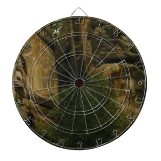 yellow rock face with trees dartboard