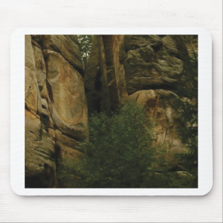 yellow rock face with trees mouse pad