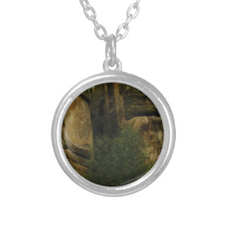 yellow rock face with trees silver plated necklace