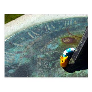 Yellow snail visiting a sundial postcard