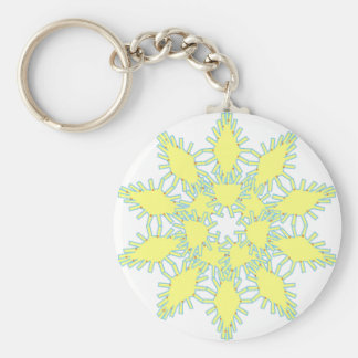 Yellow snowflake icon graphic on black background. basic round button keychain