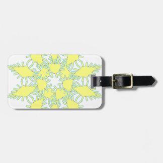 Yellow snowflake icon graphic on black background. luggage tag