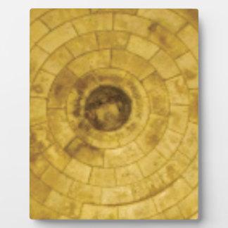yellow stone circles plaque