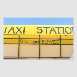 Yellow taxi station at coast in Greece