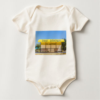 Yellow taxi station at coast in Greece Baby Bodysuit