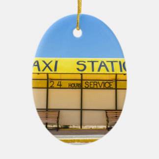 Yellow taxi station at coast in Greece Ceramic Oval Ornament