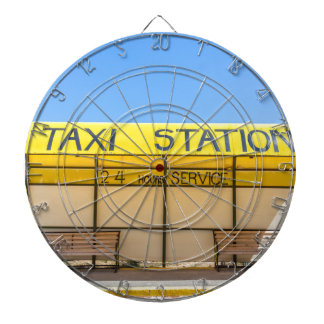 Yellow taxi station at coast in Greece Dart Board