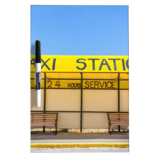Yellow taxi station at coast in Greece Dry Erase Board