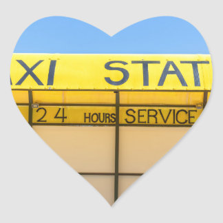 Yellow taxi station at coast in Greece Heart Sticker