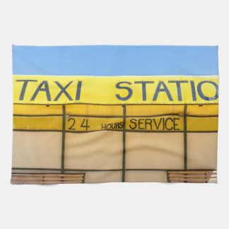 Yellow taxi station at coast in Greece Kitchen Towel