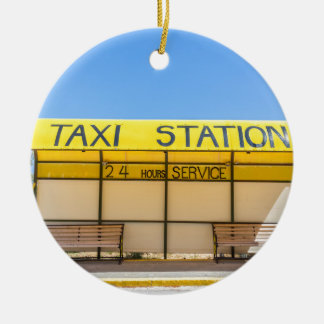 Yellow taxi station at coast in Greece Round Ceramic Ornament
