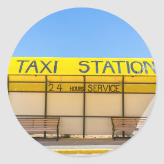 Yellow taxi station at coast in Greece Round Sticker
