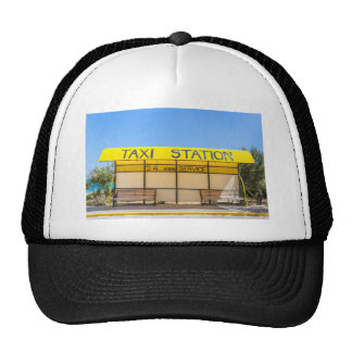 Yellow taxi station at coast in Greece Trucker Hat