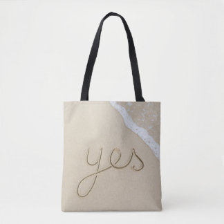 Yes carved word on the beach sand tote bag