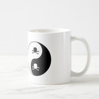 Yin and yang skulls coffee mug