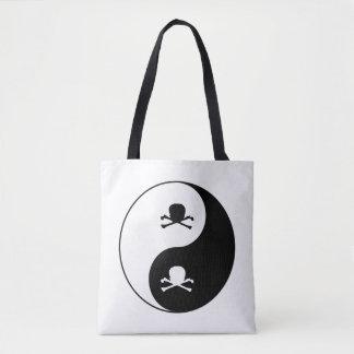 Yin and yang skulls tote bag