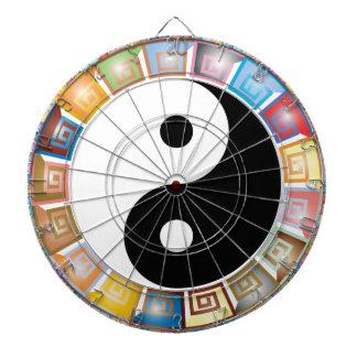 yin yang eastern asian philosophy dartboard with darts