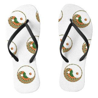 Yin-yang motif in bright nautilus swirl flip flops