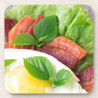 Yolk, fried bacon, herbs and lettuce close-up coaster