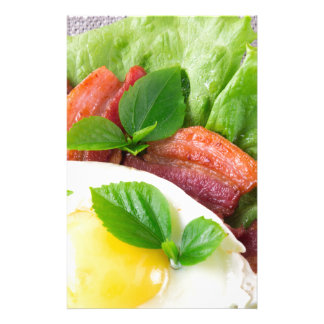 Yolk, fried bacon, herbs and lettuce close-up customized stationery