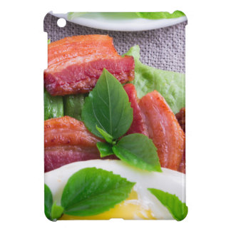 Yolk, fried bacon, herbs and lettuce close-up iPad mini case