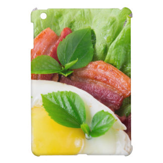 Yolk, fried bacon, herbs and lettuce close-up iPad mini covers