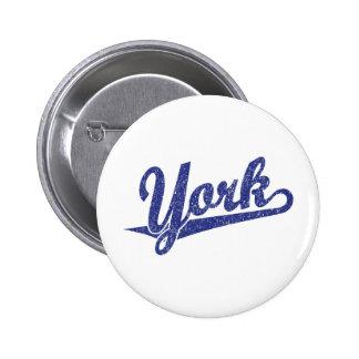 York script logo in blue distressed pins