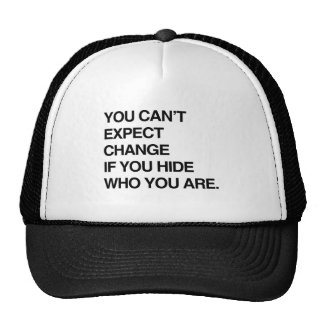 YOU CAN'T EXPECT CHANGE IF YOU HIDE WHO YOU ARE.pn Trucker Hat