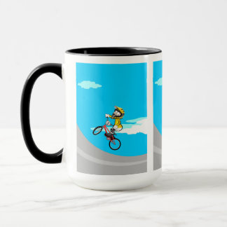 Young BMX with its bicycle jumping in the incline Mug