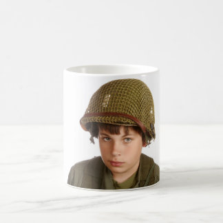 Young boy dressed as a soldier. coffee mug